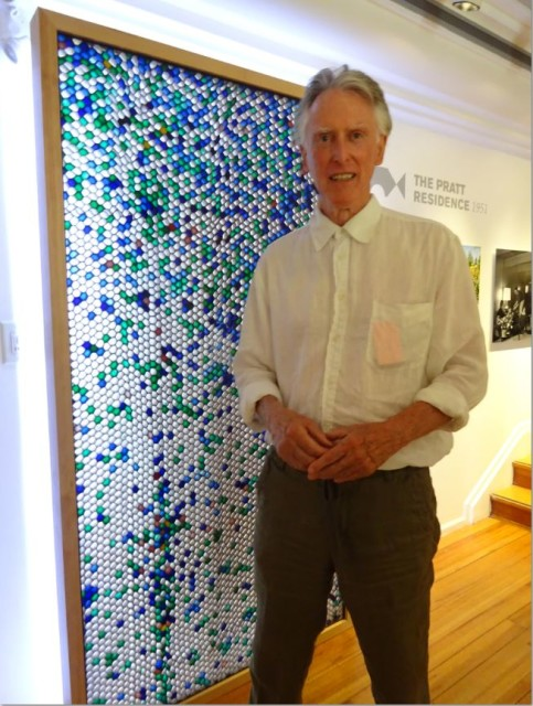 Peter Pratt in front of the mural designed by Ned Pratt and Ron Thom made from paper, coloured dyes and fibreglass. Eve Lazarus photo, 2015