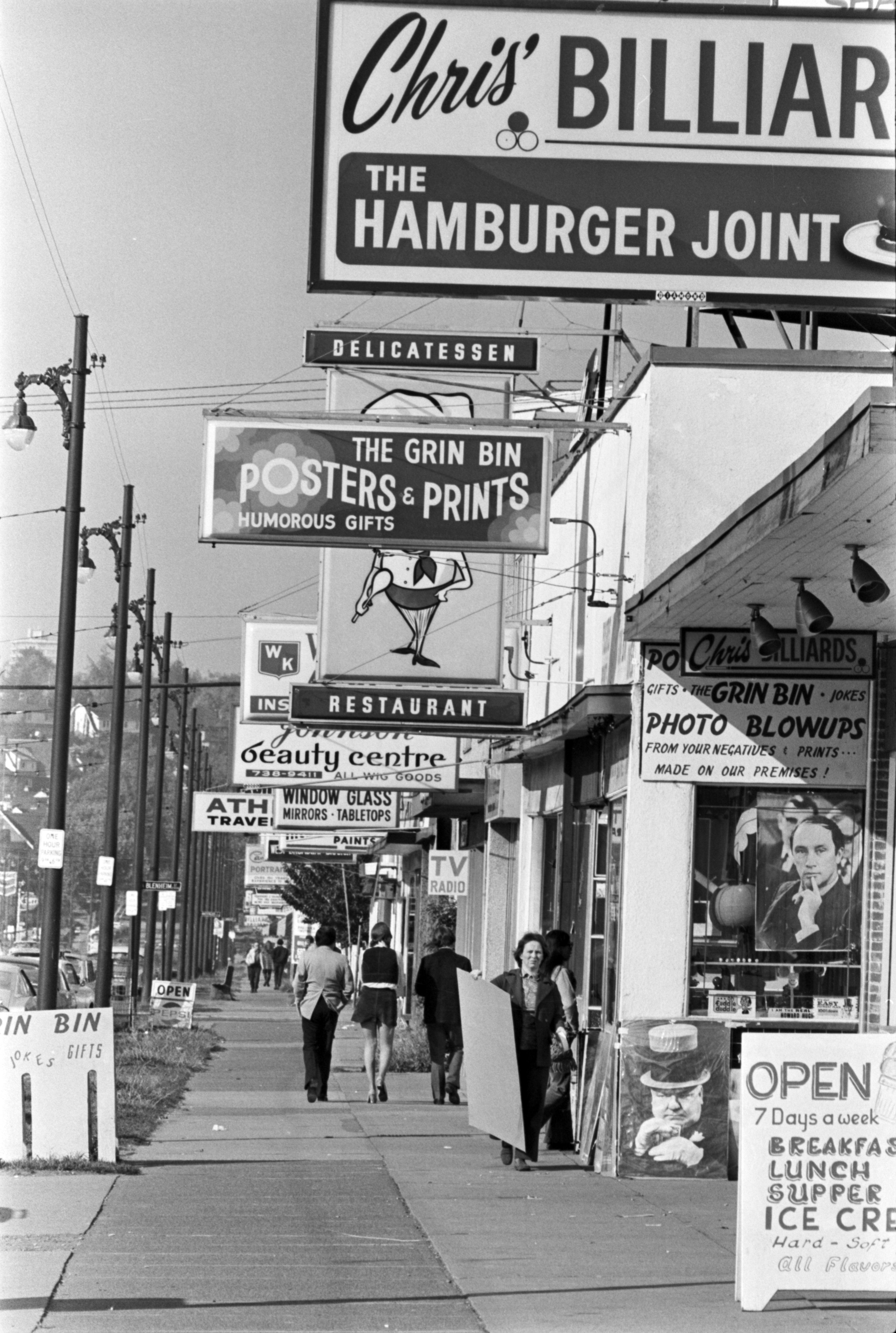 Broadway Street, between Trafalgar Street and Blenheim. The Grin Bin posters and prints, Chris' Billiards, The Hamburger Joint. October 5, 1972. Steve Bosch/Vancouver Sun (72-3291)